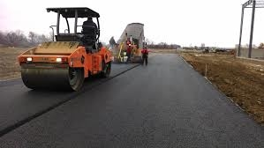 laying and rolling the asphalt